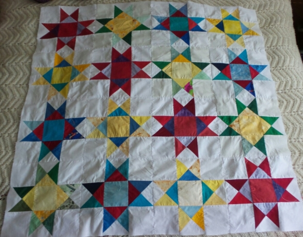 Ohio star quilt 16 blocks colours include red blue green